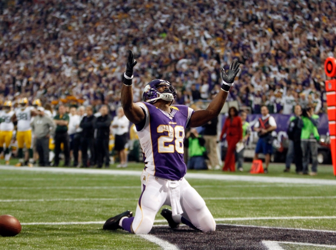 Vikings running back Peterson celebrates touchdown during NFL football game against Packers in Minneapolis